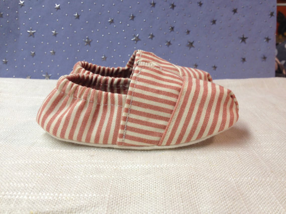 These baby slippers. I really want an adult sized pair. Spotted in this etsy shop http://www.etsy.com/listing/113352776/fitted-baby-shoes-in-a-beachy-stripe-by
