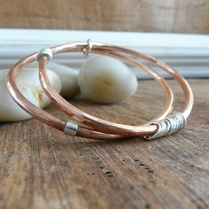 This duo of copper and sterling silver is from Stilosissima on etsy.